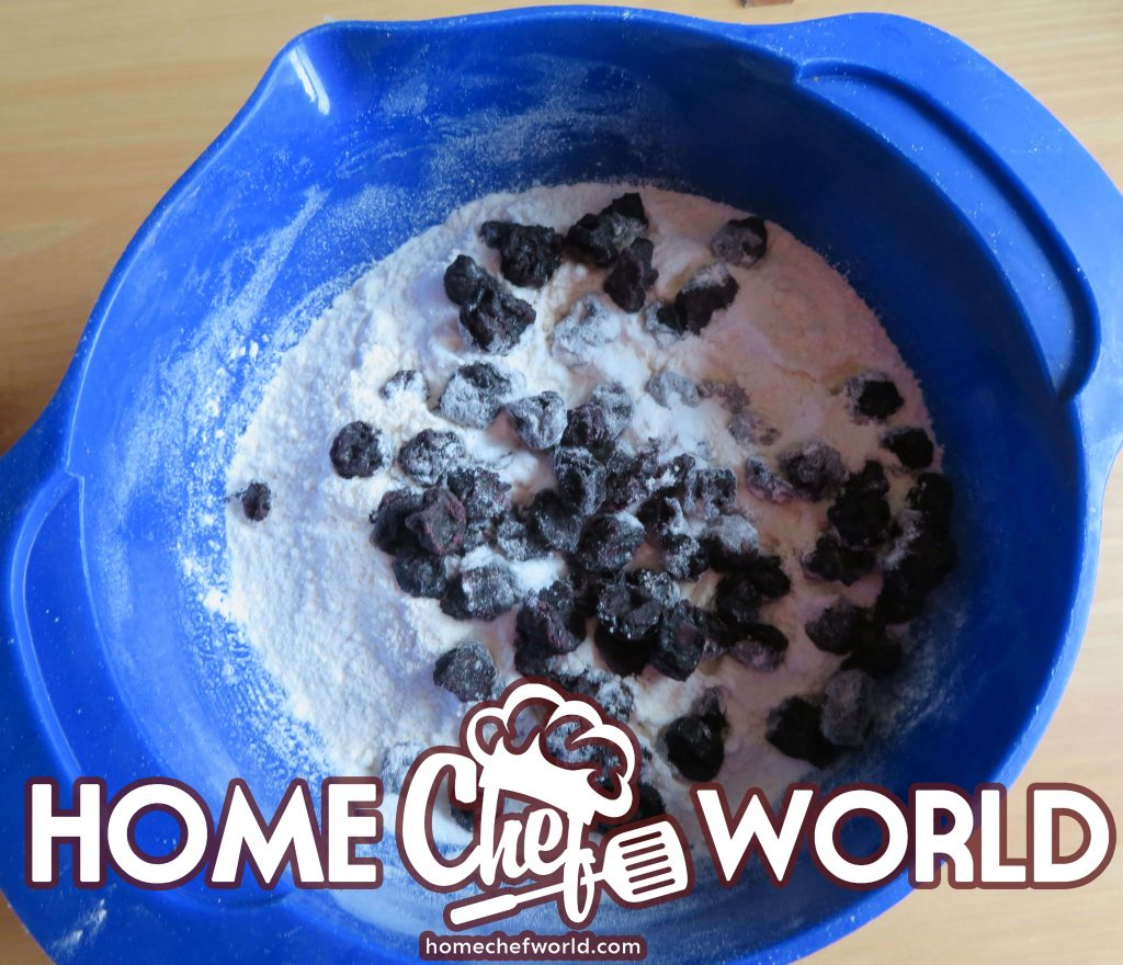 mix blueberries with a bit of flour