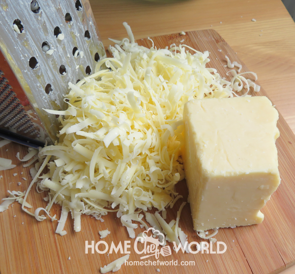 Grate Cheese for Mac and Cheese Recipe