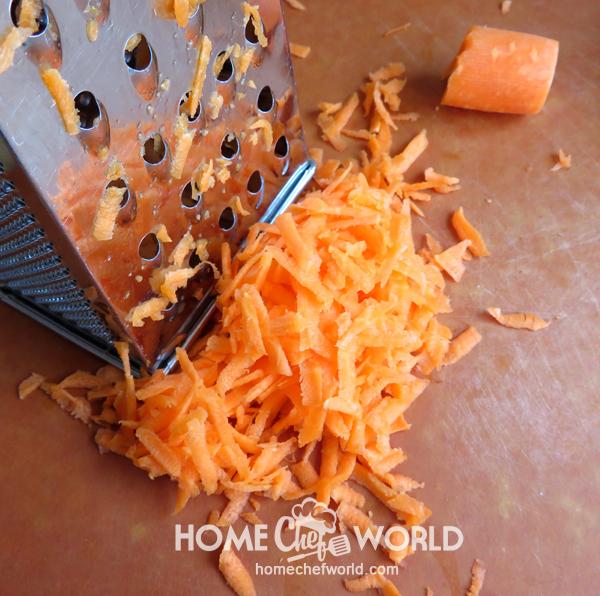 Grating Carrot for Classic Pork Fried Rice Recipe