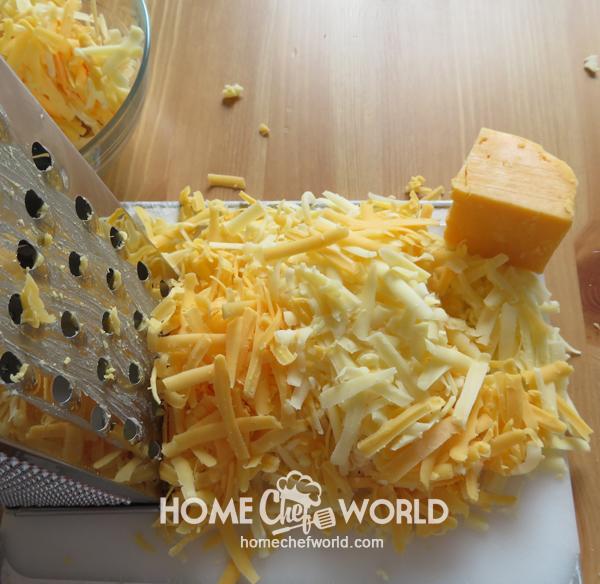 Grating the Cheese for Frank & Potato Bake Recipe