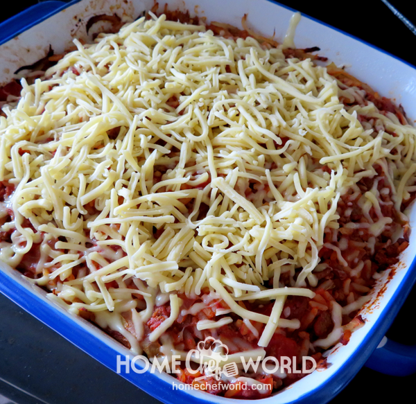 Adding Cheese over the Mixture for Cabbage Roll Casserole