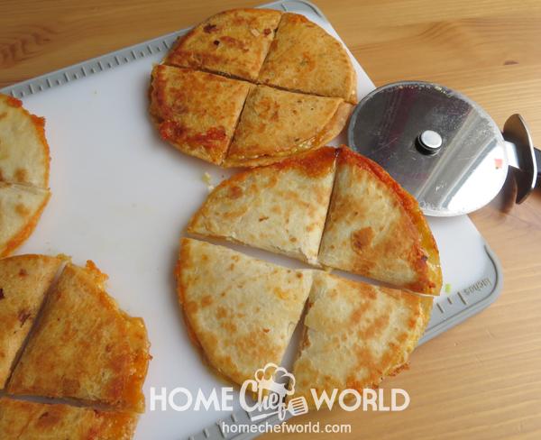 Cutting into Quarters Tortilla for Cheese Quesadilla