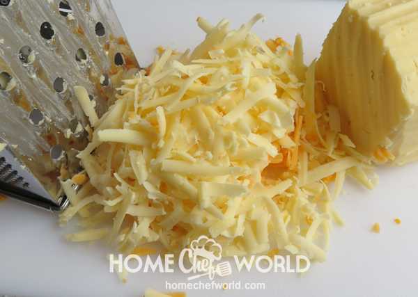 Grating-the-Cheese-for-Cheese-Quesadillas-Recipe
