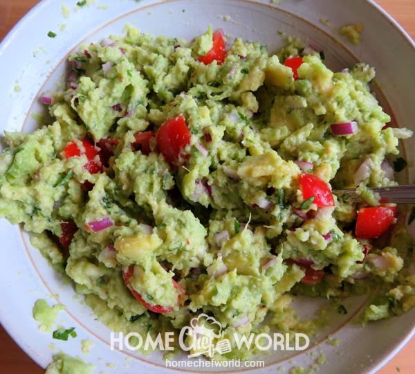 Mixing All Ingredients for Avocado Guacamole Recipe