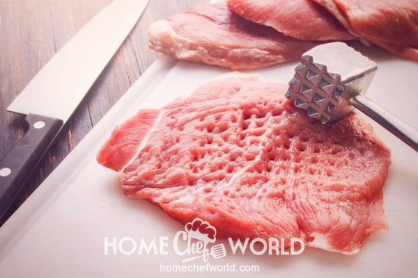 Tenderizing Meat with the Mallet for Cube Steak
