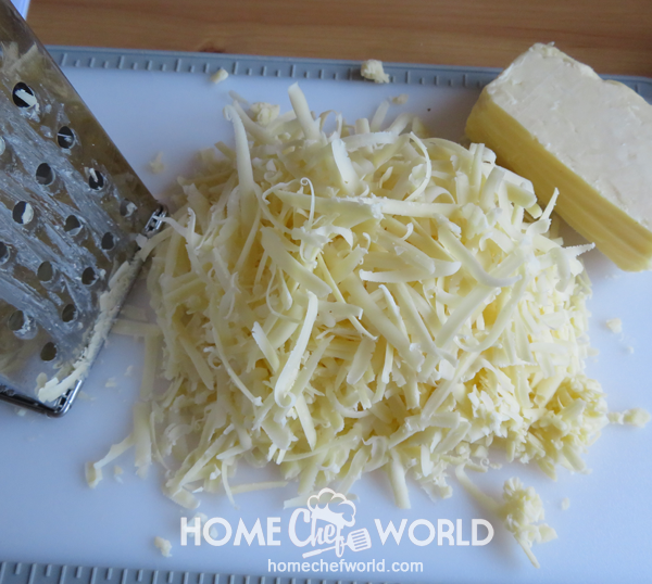 Grating Cheese for Cheesy Chicken Spaghetti