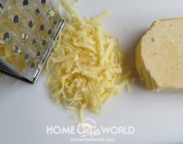Grating the Cheddar for Hasselback Chicken