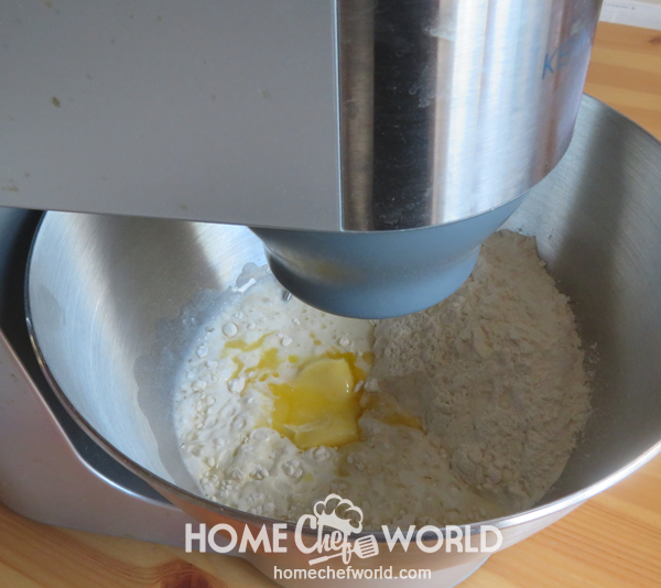 Mixing Ingredients for Pizza Dough in the Bowl