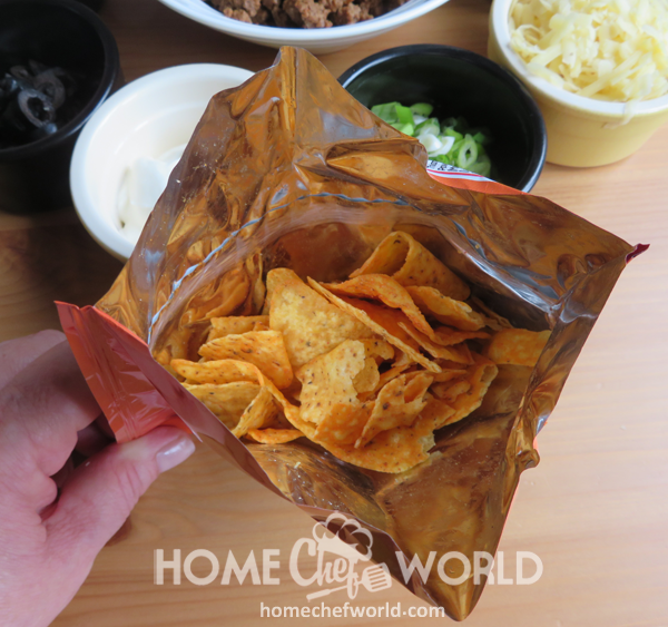 Cutting Open Bag of Tortilla Chips